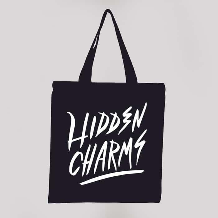 Hidden Charms black tote bag - Hidden Charms