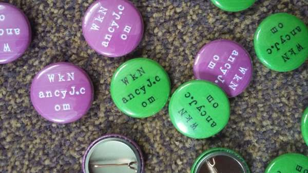 25 mm www badge PINK or GREEN - Who Killed Nancy Johnson?